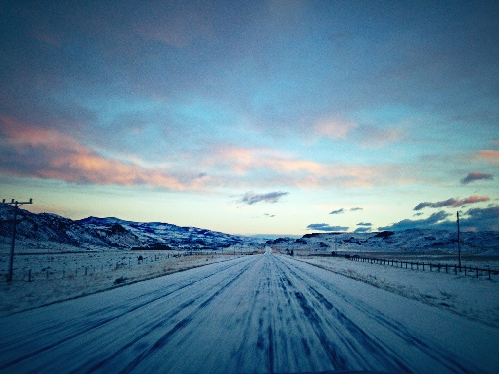 Pink Clouds on a Snowy Road